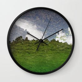 The Sky swims in the lake Wall Clock