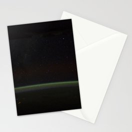 Comet Lovejoy is visible near Earths horizon in this nighttime image photographed by NASA Stationery Cards