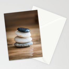 Pile of small wet pebbles on rustic wood front view Stationery Cards