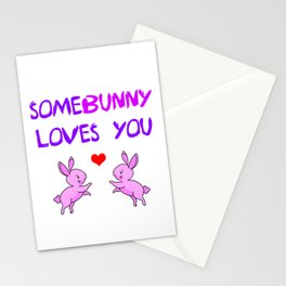 Some bunny loves you wordplay. Funny animal pun. Two little playful cute pink bunnies and red heart Stationery Cards