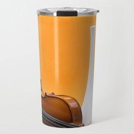 Still life with violin and white vase on an orange Travel Mug