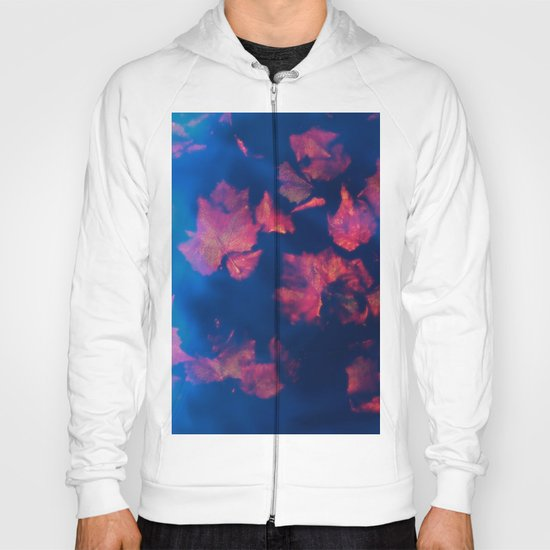 Rusty red falling leaves in dark blue water Hoody