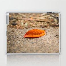 Orange leaf lying on the street Laptop & iPad Skin