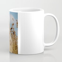 Lenz gently blowing the stalks Coffee Mug