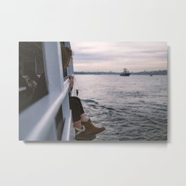 A beautiful girl enjoying Istanbul city view from the sea at sunset Metal Print