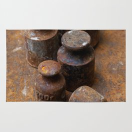 Old weights for scales Rug