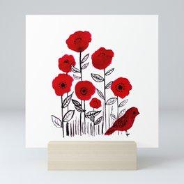 Tall poppies and red bird Mini Art Print