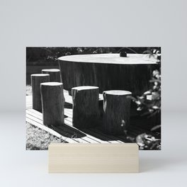 Table and seats outside Mini Art Print