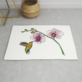 Little bird and an orchid Rug