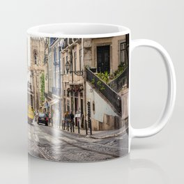 Tram 28 transports tourists through Alfama district in Lisbon, Portugal Coffee Mug
