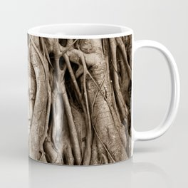 Buddha head in a Banyan Tree in Ayutthaya, Thailand Coffee Mug