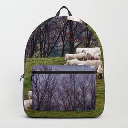 Cattle Eating Hay on a Hill Backpack