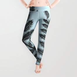 Black lace fern on powder blue background Leggings