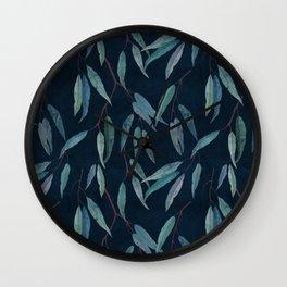 Eucalyptus leaves on indigo blue Wall Clock
