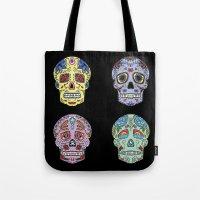 sugar skulls Tote Bags featuring Sugar Skulls by katherinejago
