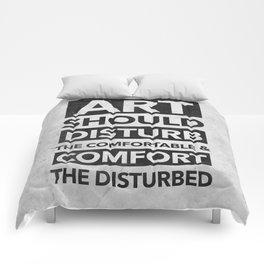 Art should disturb the comfortable & comfort the disturbed Comforters