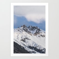Clouds roll over the snow covered mountains of Innsbruck in Austria. Art Print