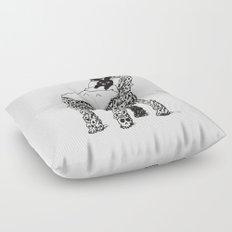 The Black Bunny of Doom in his bed of skulls Floor Pillow