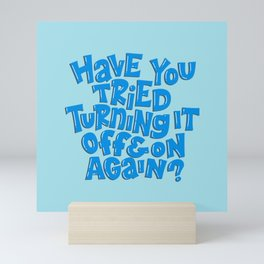 Have you tried turning it off and on again? Mini Art Print