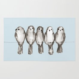 Five gray birds on a wire Rug