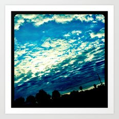 Over the shoulder clouds. Art Print