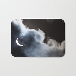 Partial solar eclipse viewed through clouds Bath Mat