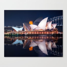 The White Shell Roofs of Sydney Opera House at Night with reflections in the water Canvas Print