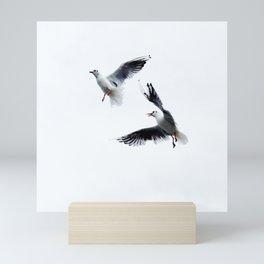 Two seagull birds flying in a sky Mini Art Print