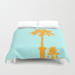Orange palm trees silhouettes on blue Duvet Cover