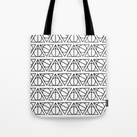 deathly hallows Tote Bags featuring Deathly Hallows by bookotter
