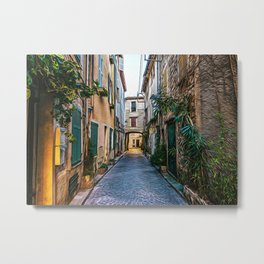 Little alley in the medieval village of Antibes in a sunny winter day Metal Print