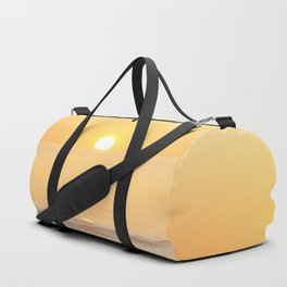 Peachy sunrise seascape Duffle Bag