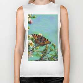 The butterfly collecting pollen on a flower Biker Tank