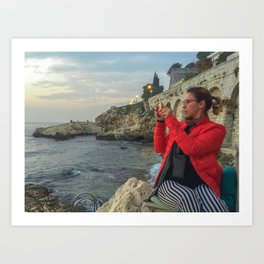 Woman taking a picture in a beach in the Rovinj city center Art Print
