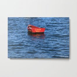 red row boat on blue water Metal Print
