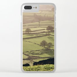 Hazy light at sunset over a valley of fields. Derbyshire, UK. Clear iPhone Case