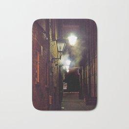 vintage lamplight - foggy alleyway Bath Mat