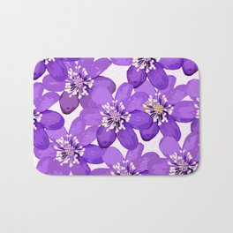 Purple wildflowers on a white background - spring atmosphere Bath Mat