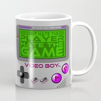 video game Mugs featuring Don't Hate The Player, Hate The Game!  |  Video Game by Silvio Ledbetter