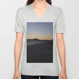 The sunrise during the morning hours at the beach of byron bay Unisex V-Neck