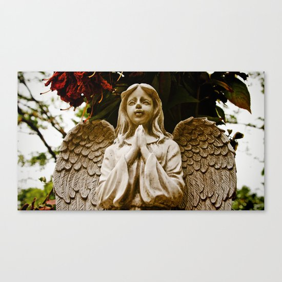 The angel prays Canvas Print