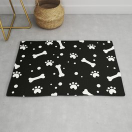 White dog paw and bones pattern on black background Rug