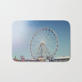 Fairground and ferris wheel against a blue sky, Blackpool Bath Mat