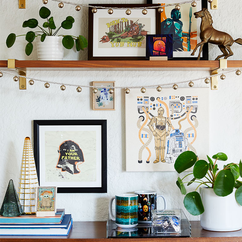 shelf with star wars and mandalorian themed art