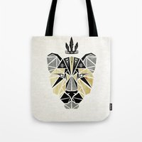 lion king Tote Bags featuring lion king by Manoou