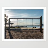 Swing Set Backlit by the Setting Sun Art Print