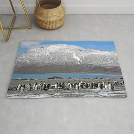 Snowy mountain with King Penguins in the Foreground Rug