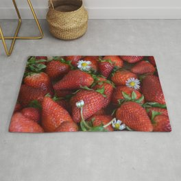 Macro strawberry and camomile with natural light Rug