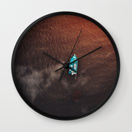 A boat on the ocean Wall Clock