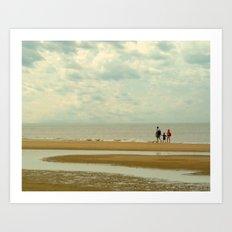 Walkers on the beach Art Print
